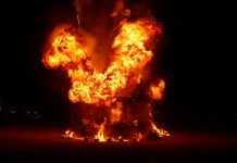 burning man attendee jump into fire